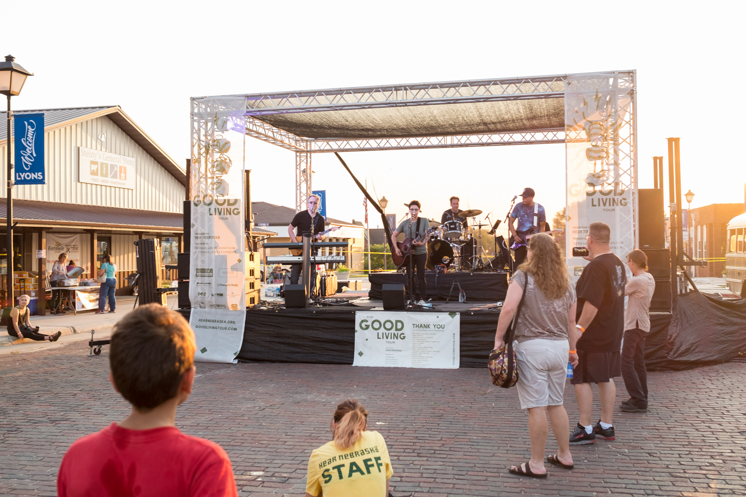 Community members listen to one of the Nebraska bands playing on Lyons Main Street, made possible by Hear Nebraska.