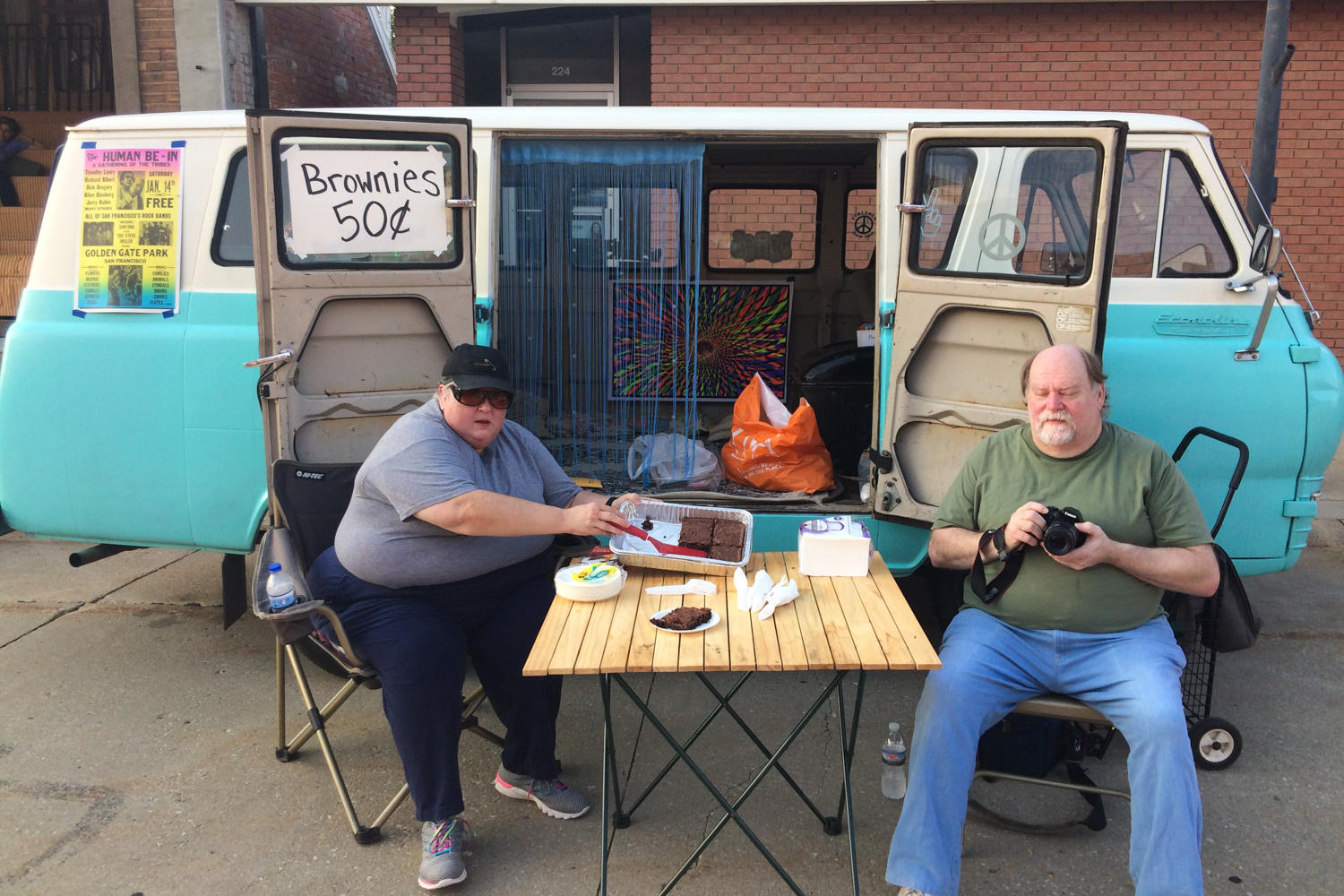 "Utilizing a ""hippie van"" owned by Lyons resident Bill Hedges, community members hosted a bake sale of brownies. By the end of the night, they were sold out."