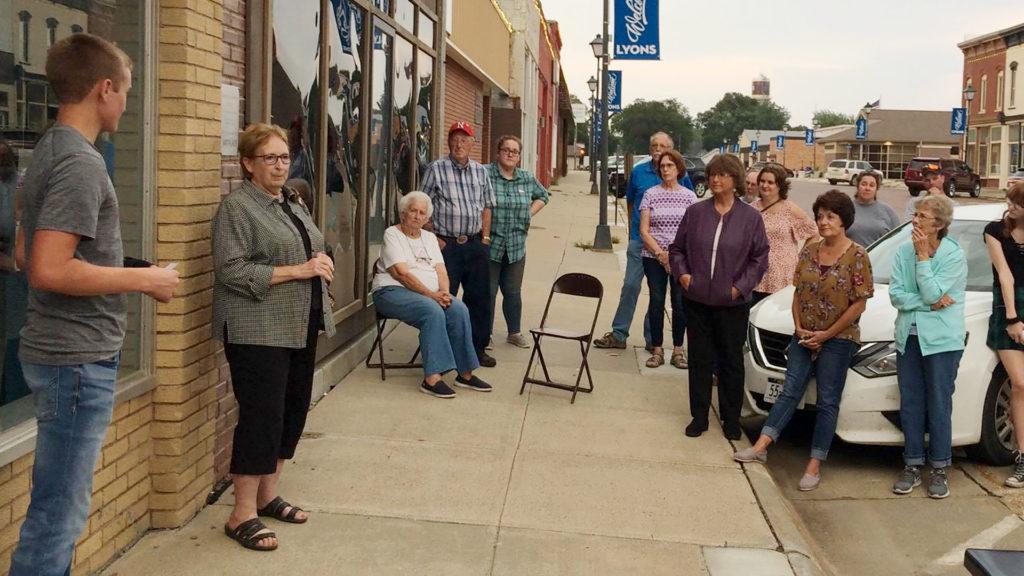 Senior students and senior citizens have a conversation on Main Street Lyons during Senior Spotlight.